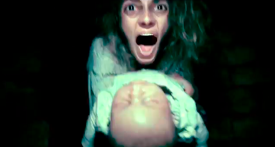 I'm pretty sure you couldn't see in the green band trailer that she was holding what appears to be a dead infant...